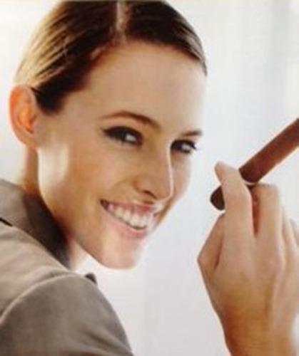 Woman with Cigar.  (PRNewsFoto/Dr. Surender R. Neravetla)