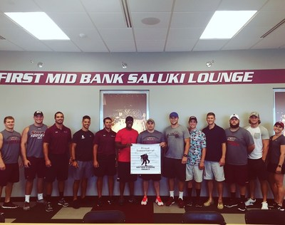 Warriors pose with Southern Illinois University staff, during a workout event sponsored by Wounded Warrior Project.