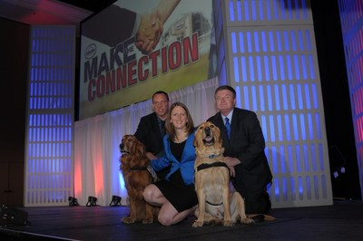Choice Hotels' Suburban Extended Stay brand partners with America's bravest by supporting Maryland-based Warrior Canine ConnectionPictured: (Humans)Rick Yount, founder and executive director of Warrior Canine ConnectionCaragh McLaughlin,  head of brand management for Suburban Extended Stay, Choice Hotels InternationalBill Petschonek, director of brand strategy for Suburban Extended Stay, Choice Hotels International(Canines)Huff (left)Ron (right) (PRNewsFoto/Choice Hotels International, Inc)