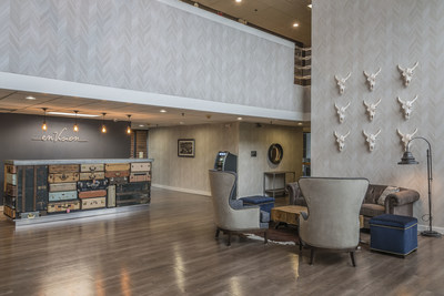 The front desk in the lobby of enVision Hotel St. Paul South, an Ascend Hotel Collection member, is made out of antique suitcases, one of the many vintage-inspired pieces displayed throughout the property.