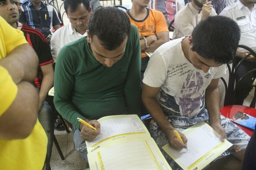 The handbook provides laborers with general personal finance principles tips and a monthly income tracker. In the photos laborers logging in their expenses. (PRNewsFoto/The Western Union Company)