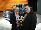 2015 Ram Power Wagon named Four Wheeler Magazine's Pickup Truck of the Year: (Left to right) Rick Pewe, Content Director for the Four Wheeler Network and Bob Hegbloom, President and CEO of Ram Truck Brand.