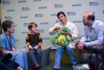 At a recent dental fair celebrating the endowment and partnership, one attendee learns about the importance of dental care at an early age from experts Dr. Man Wai Ng, Dentist-in-Chief at Boston Children's Hospital Department of Dentistry, Dr. Harleen Kumar, Fellow in Advanced Pediatric Dentistry, and Dr. Brian Nový, Director of Practice Improvement, DentaQuest Institute.