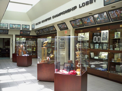 Located in Coral Gables, Fla., the University of Miami Sports Hall of Fame recognizes student athletes, coaches and administrators who have contributed the most to Hurricanes Athletics over the years. On display are photos of each of the inductees, the National Championship Trophies for football and baseball, as well as the Heisman Trophies of Vinny Testaverde and Gino Torretta. The display includes basketball memorabilia from the Rick Barry years along with items from all of the university sports programs. (PRNewsFoto/University of Miami Sports Hall of Fame)