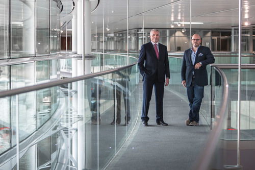 Photographed (left to right): Dr. Geoff McGrath, Managing Director, McLaren Applied Technologies and George Slessman, CEO and Product Architect, IO, form partnership to make data centers more energy efficient.  (PRNewsFoto/IO)