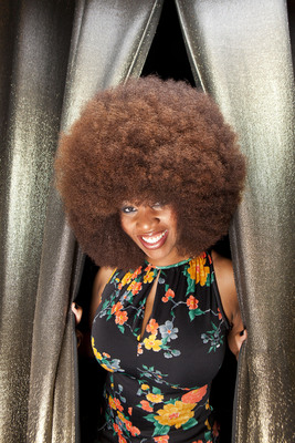 """Aevin Dugas (USA) is the proud owner of the Guinness World Record-breaking """"Largest Afro."""" When measured in New Orleans, USA, on October 4, 2010, it had a circumference of 4 ft 4 in. She trims her afro two or three times a year, and uses up to five conditioners at once when she washes it. Dugas is featured in the Guinness World Records 2012 edition book, available today for $28.95. (Photo Credit: Chris Granger/Guinness World Records).(PRNewsFoto/Guinness World Records)"""