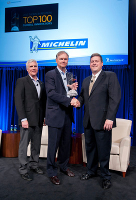 Michelin named one of the Top Global Innovators by Thomson Reuters--Terry Gettys (center), Michelin Group's director of research and development, receives a Top Global Innovator award from David Brown (right), managing director, Thomson Reuters IP Solutions. Also on hand for the presentation was David Stafford (left), COO of Michelin Americas Research Company.  (PRNewsFoto/Michelin)