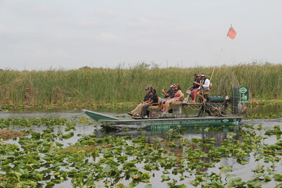 Wounded veterans get up close and personal with alligators during airboat tour.