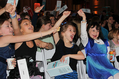 "Students cheered as winners of the ""Battle of the Brains"" competition were announced. Two teams won the grand prize of $50,000 and their proposals being built as full-scale science exhibits; four runners-up won $5,000; and 14 honorable mentions won $2,500.  (PRNewsFoto/Burns & McDonnell Foundation)"