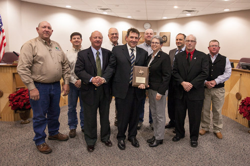 Apache Corporation employees and representatives of the Brazos Valley Groundwater Conservation District pose ...