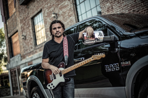 The Ram Truck brand continues partnership with Latin music superstar Juanes in all-new Spanish-language commercials for the 2014 Ram 1500. The campaign focuses on the class-leading innovations of the 2014 Ram 1500, emphasizing values such as hard work and determination shared by the brand and Latin cultures.  (PRNewsFoto/Chrysler Group LLC)