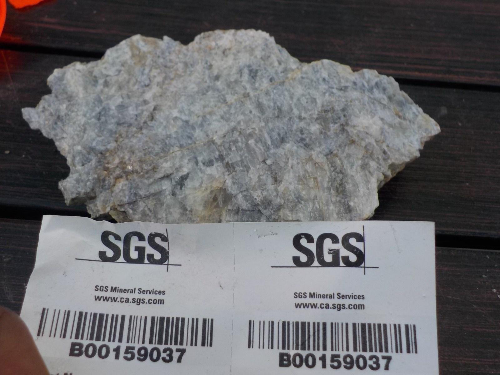 Figure 1 Grab sample 159037 of pure petalite with 4.43 % Li2O from Marko's pegmatite, Paterson Lake Property, Ontario.
