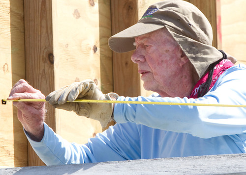Former President Jimmy Carter working on a home in Leogane, Haiti, during Habitat for Humanity's 2012 Jimmy  ...