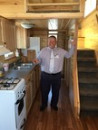 "Scott Sirois, Soboba Casino's General Manager is pictured here inside and with the key to the Tiny Home that will be given away this September in the casino's promotion ""Tiny Home, Giant Free Play."" The grand prize is a tiny home built by Rich's Portable Cabins and that will be featured in an upcoming episode of FYI channel's program ""Tiny House Hunters."""