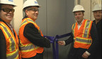 On left, Larry Wash and Kelly Leitch from KONE Americas, alongside Geoffrey Matthews and Chris Mallinos, leaders from Great Gulf, cut the ribbon at North Americas' first KONE JumpLift. The technology will enable faster and safer construction at Great Gulf's flagship condominium project in Toronto.