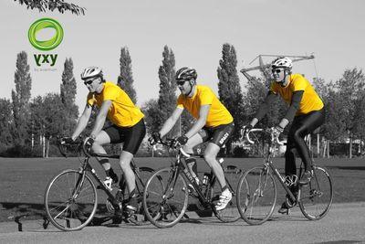 Three guys on their bicycles wearing the PEF T-shirts. (PRNewsFoto/Avantium)