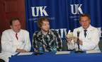 Dr. Mark Plunkett (right) explains the SynCardia temporary Total Artificial heart during a news conference held at University of Kentucky Medical Center on March 5, with Dr. Charles Hoopes and patient Zack Poe. Later that day, Zack became the first Total Artificial Heart patient in the state to be discharged from the hospital using the Freedom(R) portable driver.  (PRNewsFoto/SynCardia Systems, Inc.)