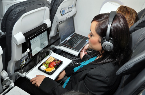 Alaska Airlines will start flying its first aircraft with 110-volt and USB power outlets at every seat next ...