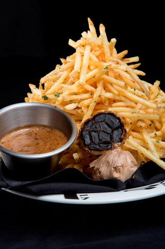 Black FRYday at Serendipity 3 at Caesars Palace: black truffle shoestring fries accompanied by black garlic ...