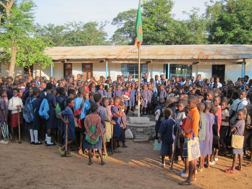 Students gather outside one of the classrooms at Mayukwayukwa High School, Zambia.  (PRNewsFoto/Yingli Green ...