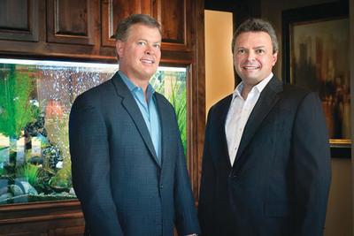 Drs. John Christian Schiro and Arturo R. Gacria.  (PRNewsFoto/Austin Cosmetic Dentistry)