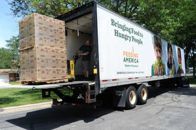 "An employee of Feeding America Eastern Wisconsin moves a pallet of food that will be used to help feed families struggling with hunger in the Milwaukee area. Feeding America, the nation's largest provider of charitable food assistance to low-income Americans, today unveiled ""Hunger In America 2014"" which showed 1 in 7 Americans, more than 46 million people, including 12 million children, rely on food pantries and meal service programs to feed themselves and their families. (PRNewsFoto/Feeding America)"
