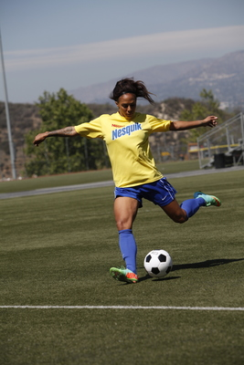 Sydney Leroux, the US Women's National team forward and Gold Medalist, demonstrates technique in front of youth players as part of a partnership with NESQUIK to spread the word about refueling after play.