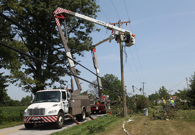 More than 3,200 FirstEnergy utility and support employees, along with 1,000 contractors and crews from other utilities, have been working around-the-clock to restore service for customers following Friday's storm.  Pictured are Ohio Edison employees, wrapping up restoration efforts in Springfield, Ohio.  (PRNewsFoto/FirstEnergy)