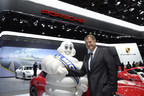 The Michelin Man and Porsche Cars North America President and Chief Executive Officer Detlev von Platen Celebrate Porsche Experience Center Partnership