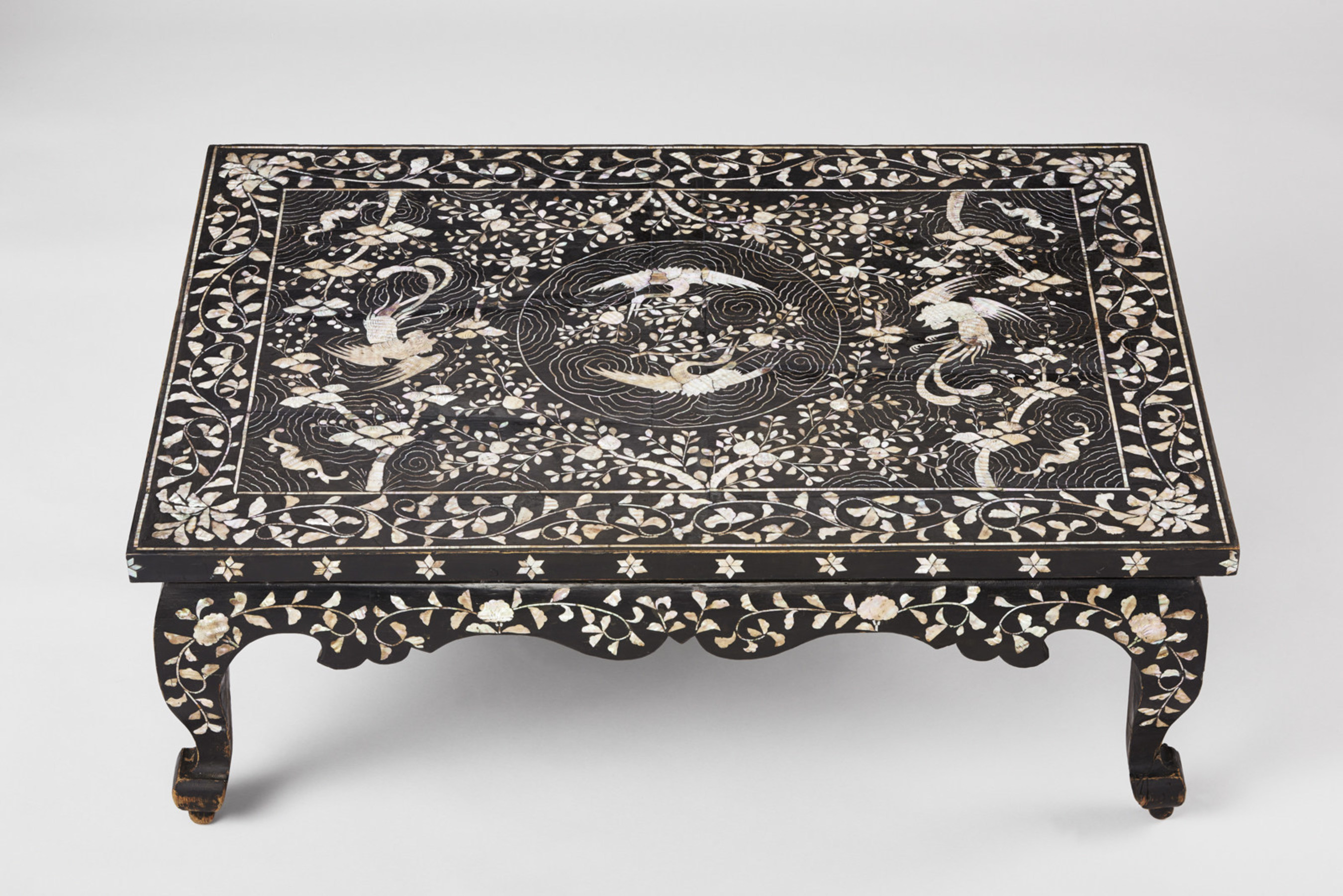 Table with phoenix, crane, and peach motif, 1800-1900. Korea, Joseon dynasty (1392-1910). Lacquered wood with inlaid mother-of-pearl. Asian Art Museum, Museum purchase, 2016.39. Photograph (C) Asian Art Museum.