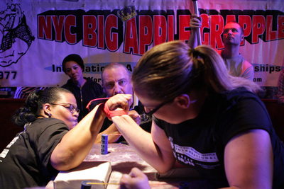 Joyce Boone from Brooklyn (Left) battles with current Queen of Arms title holder Ana Kenah from Jersey City, The rematch will be held at the 37th Annual NYC Big Apple Grapple International at Cheap Shots Sports Bar in Flushing NY on Sunday, April 27, 2014 at 1 pm - The event is sponsored by sponsored by Quantum Wellness Healing Center and Spa. (PRNewsFoto/NYAWA)