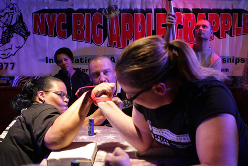 Joyce Boone from Brooklyn (Left) battles with current Queen of Arms title holder Ana Kenah from Jersey City, ...