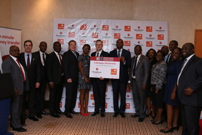 Alex Holmes, MoneyGram's CEO and Tayo Asupoto, general manager of GT Bank (both in the center) signed an agreement allowing cash-to-account international sends to Nigeria.