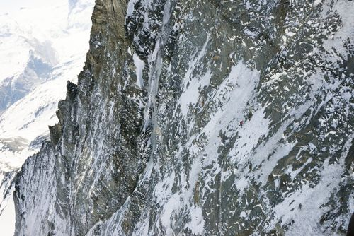 Mammut Pro Team Athlete Dani Arnold on record course in the 1100 meter high North Face of the Matterhorn. Photo  ...