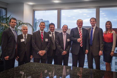The Trump family - including Donald Trump, Sr., Eric, Ivanka and Donald, Jr. - YY Development Group partners, and architect Berardo Dujovne at a press conference announcing Trump Tower Punta del Este. Developed by YY Development Group and designed by Dujovne-Hirsch & Associates, the $100 million ocean-front tower, situated in exclusive Punta del Este, Uruguay, marks the Trump brand's first foray into South America.  (PRNewsFoto/YY Development Group)