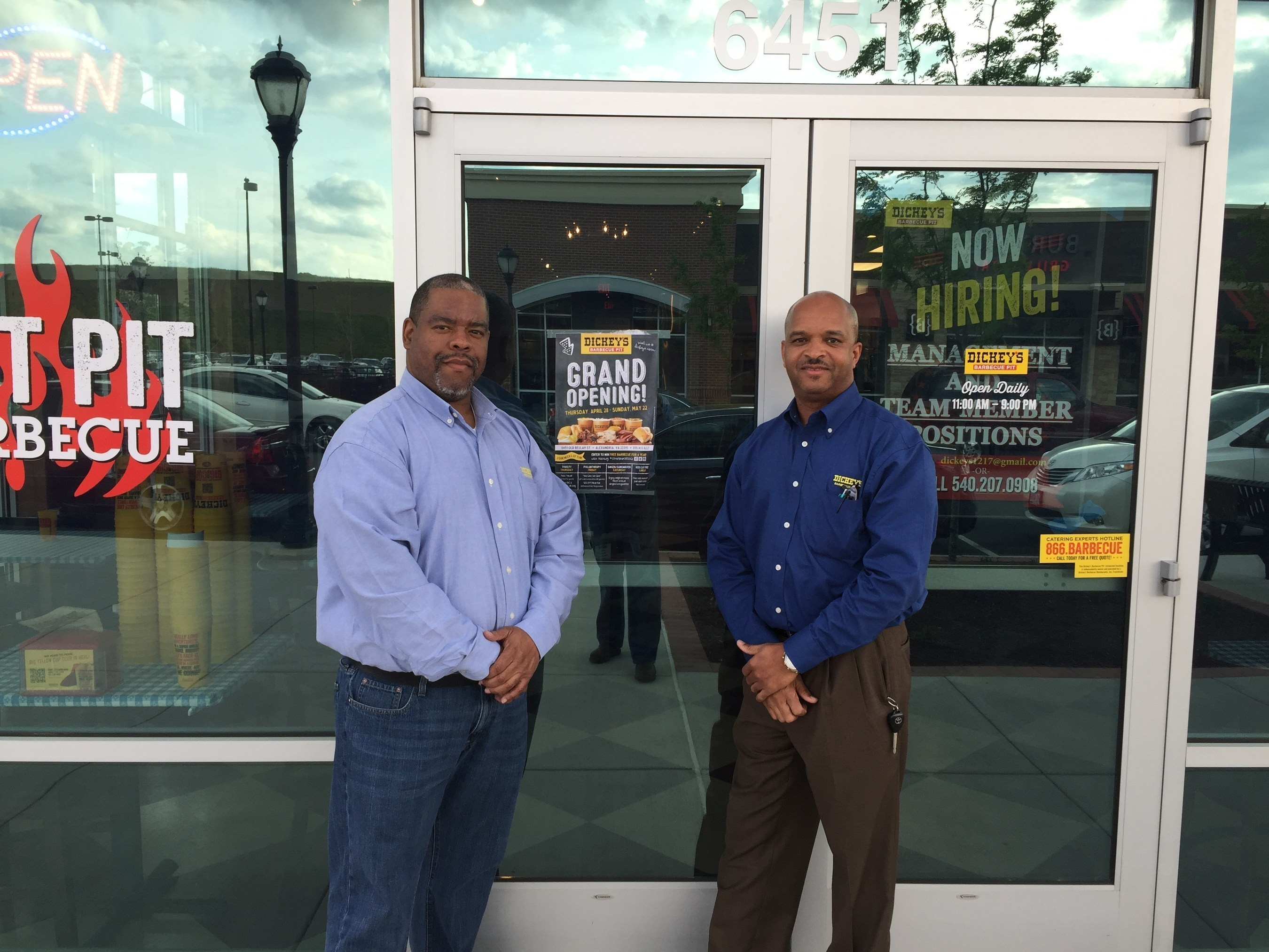 Owner/Operator James Wright (left) stands outside of his new Dickey's location in Alexandria.