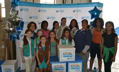 Astoria Federal Savings Vice President of Marketing Communications Irene Ferrall (back left) and Astoria South Huntington Branch Manager and Vice President, Banking Division Maria Scorcia (third from right) pose with Girl Scouts at Astoria's 14th Annual Kids Tools for School Distribution Day.  Astoria partnered with Girl Scouts from Nassau and Suffolk Counties to distribute collected school supplies to disadvantaged children.  (PRNewsFoto/Astoria Federal Savings)