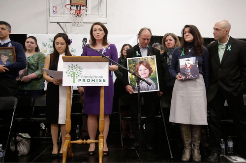 Nelba Marquez Greene, mother of Ana, third from left, and Nicole Hockley, mother of Dylan, fourth from left, read the Sandy Hook Promise surrounded by other families of victims of the December 14 tragedy at the launch of Sandy Hook Promise in Newtown, CT. The group urged supporters to make the promise at sandyhookpromise.org to turn this tragedy into transformation. (PRNewsFoto/Sandy Hook Promise) (PRNewsFoto/SANDY HOOK PROMISE)