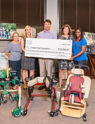Cox Enterprises Executive Vice President Alex Taylor Presents a $125,000 Grant to Fragile Kids Foundation on behalf of the James M. Cox Foundation. The grant will allow Fragile Kids Foundation to purchase 70 additional pieces of therapeutic and rehabilitative equipment. (DIN Photography) (PRNewsFoto/Cox Enterprises)