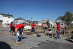 Diageo employees help Habitat for Humanity rebuild homes in Breezy Point, Queens a year after Superstorm Sandy.  (PRNewsFoto/Diageo North America)