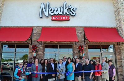 Lake Charles, La. Mayor Randy Roach cuts the ribbon in celebration of Newk's Eatery's 100th restaurant opening and kick-off for a $100,000 fundraising campaign for the Ovarian Cancer Research Fund Alliance.