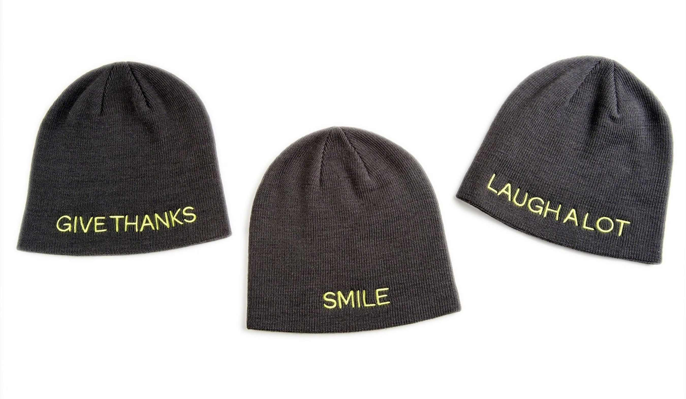 """The Giving Hat(TM) is a stylish winter knit hat, one-size-fits-all and available in three versions embroidered with messages inspired by St. Jude patients and their families: """"Smile,"""" """"Laugh A Lot,"""" and """"Give Thanks."""" The Giving Hat(TM) is available exclusively this holiday season at all Kmart stores or online at kmart.com/stjude"""