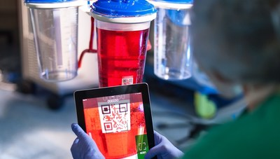 A nurse takes a snapshot of a suction canister using the iPad based Triton System.