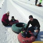 Injured service members and their families enjoy the day at Perfect North Slopes in Lawrenceburg, IN.