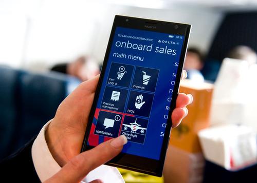Delta flight attendants will soon use Nokia Lumia 1520 devices on board.  (PRNewsFoto/Delta Air Lines)