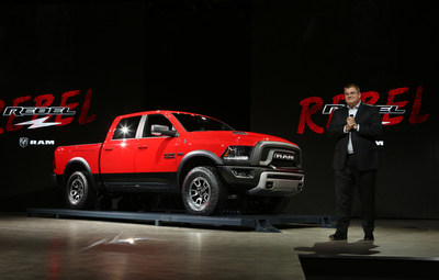 All-new 2015 Ram 1500 Rebel World Debut -- The new 2015 Ram 1500 Rebel is unveiled by Ram Truck President and CEO Bob Hegbloom. The Rebel makes a powerful visual statement with a factory lift, 33-inch tires and a bold, new exterior design. Rebel's rugged interior features seats embossed with the truck's actual tread pattern and custom trim. The 2015 Ram 1500 Rebel goes on sale early in the second half of 2015. (PRNewsFoto/FCA US LLC)