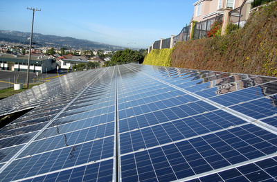 Solar panels grace the hillside at one of 15 South San Francisco Unified School District sites to receive solar arrays designed, engineered and installed by Chevron Energy Solutions.  (PRNewsFoto/Chevron Energy Solutions)