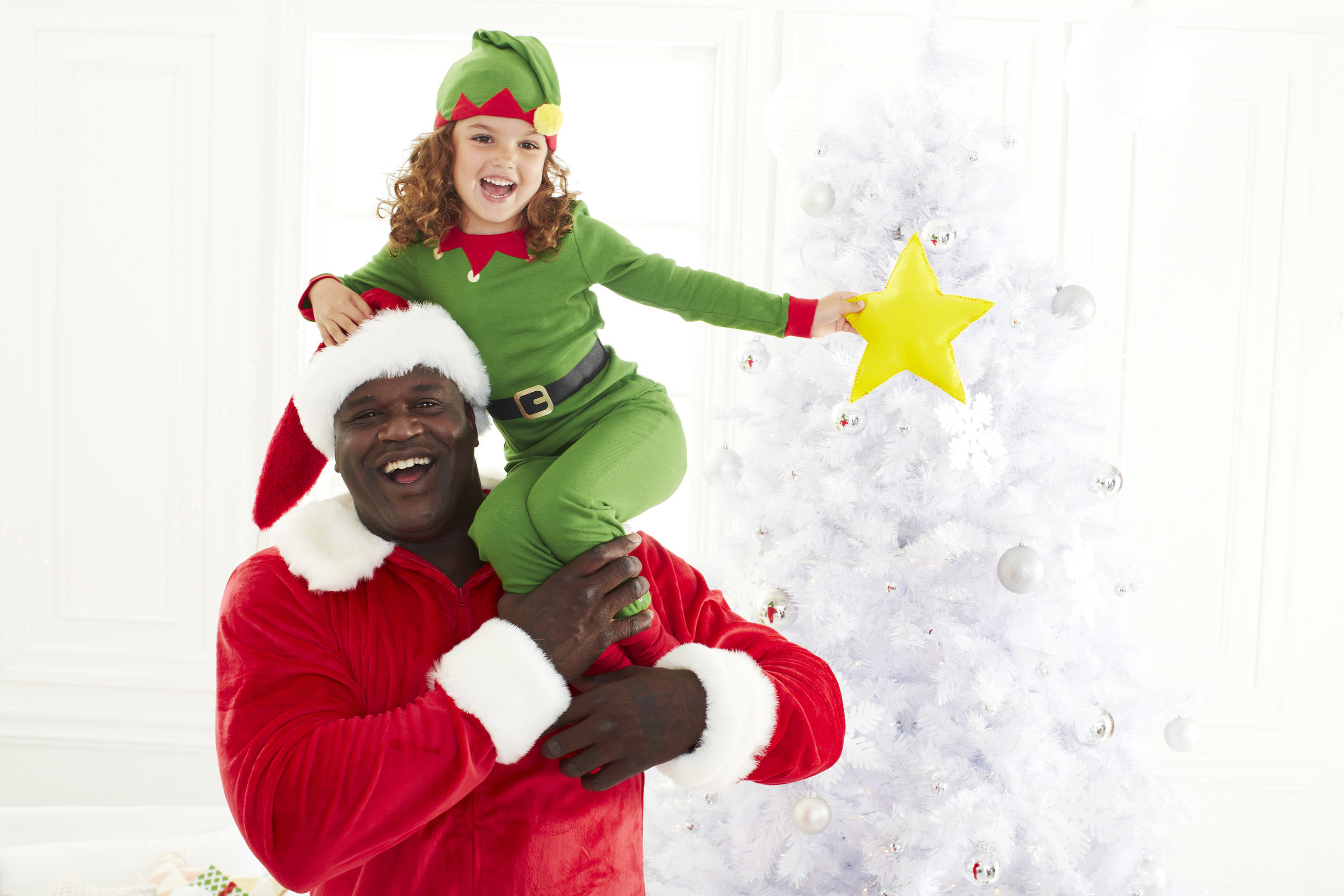 "Shaq-A-Claus is back to partner with Toys""R""Us and"