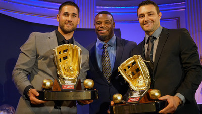 Rawlings Gold Glove Award winning center fielders Kevin Kiermaier (left) of the Tampa Bay Rays(TM) and A.J. Pollock of the Arizona Diamondbacks (right) accept their awards from Ken Griffey Jr. at the Rawlings Gold Glove Awards in New York City on November 13, 2015. Griffey, Jr. was also induced into the Rawlings Gold Gove Hall of Fame.