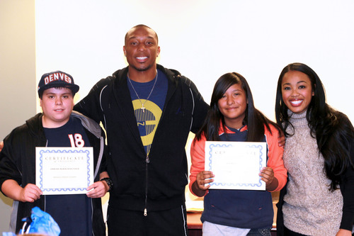 Chris Harris Jr. and his wife, Leah, congratulate Damian Rabaza-Keltner and Miranda Cruz, winners of the BBBSC Broncos Game Day Giveaway Essay Contest.  (PRNewsFoto/Big Brothers Big Sisters of Colorado)